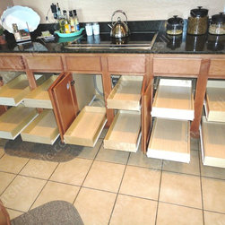Slide Out Shelves LLC - Kitchen Pull Out Shelves by slideoutshelvesllc.com - Kitchen pull out shelves roll out for easier access and organization. All pull out kitchen shelves are custom made and easy to install yourself. Photos copyright by Slide Out Shelves LLC http://www.slideoutshelvesllc.com