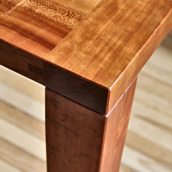Its All In The Joinery - This solid cherry table has refined joinery, tapering legs and an oil finish that brings out the natural beauty of the wood, making it a centerpiece in any casual dining space.