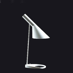 Louis Poulsen - PH 3/2 table lamp - The PH 3/2 table lamp from Louis Poulsen has been designed by poul Henningsen. This table mounted luminaire is great for diffused incandescent lighting. The PH 3/2 is composed of the base and stem in high lustre chrome plated brass with the diffuser constructed of handblown white opal glass. PH 3/2 is based on the principle of a reflecting multi-shade system, creating  harmonious and glare free illumination. The shades are drawn over a logarithmic spiral, with the center of the light source placed in the spiral's focal point.