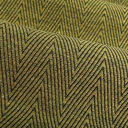 Raja Chevron Upholstery Fabric in Green - Raja is a neutral green chevron upholstery fabric that has a nicely textured hand. This cotton blend creates an eye-catching look in any interior design. Now available online at a fraction of the retail cost thanks to FabricSeen's signature discount. Made in Italy from 42% rayon and 58% cotton. Width: 59″; Repeat: L 1/2″