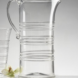 Ella Pitcher - Large - Three well-spaced bands of applied glass form elegant, stylized snakes coiling around the cylindrical base of the Ella Large Pitcher. Made entirely from clear glass, this high-concept pitcher goes from casual drinks on the patio to formal meals in the dining room - equally apropos in every setting for effortless hosting. A graceful handle curves from rim to body for a perfect finish.