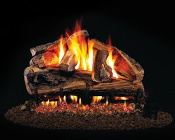 Real Fyre Rugged Split Oak Vented Gas Log Set - With a Real Fyre Rugged Split Oak Vented Gas Log Set in your gas fireplace, you'll swear you spent the afternoon splitting logs. This hand-painted refractory ceramic log set is modeled from real wood samples, with realism, texture, and nuance straight from nature. They burn efficiently while protecting natural resources and reducing pollution, providing real radiant heat for your home. Each is supported by steel rods in the center, and artfully placed about a steel burner and powder-coated grate. Choose 18 or 24 inches to fit your standard direct vent fireplace Choose propane or natural gas power source Silica sand and platinum embers included with every model Optional pilot kit and remote control Manufacturer's lifetime warranty included Heating Output Propane 18-inch: 45,000 BTU Propane 24-inch: 65,000 BTU Natural gas 18-inch: 70,000 BTU Natural gas 24-inch: 90,000 BTU Note: It is recommended that you use a professional installer to ensure the safety of the exhaust system. A licensed contractor should be contacted for installation of all products involving gas lines. About Real FyreReal Fyre understands more about the amazing things that happen when flame and good food meet. For the last 70 years, they've set out to create the singularly best way to cook food outdoors, using the highest-quality materials, innovative design, and an absolutely relentless pursuit of perfection. With a complete line of luxury-grade grills, burners, accessories, and built-in grill island components, Real Fyre is ready to turn your home into the world's best outdoor kitchen.