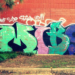 """Abby Essie - Surburban Graffiti #1 [Limited Edition of 10] Photography by Alaina - Digital capture of rare graffiti found in office park in suburban North Atlanta, 30 miles from downtown. Reads: """"Nawf Side Stand Up"""" and there are some symbols or abbreviations below, not sure what they are - could be gang related - but this is definitely not a gang endorsement. The hues of turquoise, teal, purple, and blue on brick present themselves in contradiction with the heavily wooded area. Limited Editions are signed and numbered by artist, with certificate of origin. Presented fine art paper. Contact me for additional sizes or if you prefer another fabric paper for your limited edition print."""