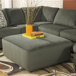 "Ashley - Jessa Place Oversized Ottoman in Pewter Fabric - With the ample seating area of this comfortable sectional making sure that everyone has the best seat in the house, the stylish contemporary design of the ""Jessa Place-Pewter"" upholstery collection features oversized set-back rolled arms along with supportive seat and back cushioning all surrounded with a plush upholstery fabric. Contemporary Design; Pewter Fabric Upholstery; Taut Upholstery; CA117 Fire Retardant Foam; Zippered Black Bottom; Plastic Triblock Feet; Durable Frame Construction; Corners are Glued, Blocked and Stapled; Upholstery pre-approved for wearability and durability against AHFA Standards; Cushion core constructed of low melt fiber wrapped over high quality foam; 100% Polyester; Spot clean with water based cleaner; Overall Dimension?: 40""W x 40""D x 20""H;"