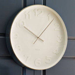 New Oversize White Wall Clock - Spare time. White-on-white numerals bring a modern, minimalist feel to this statement-making wall clock. A narrow steel frame and delicate steel hands add a metallic edge.
