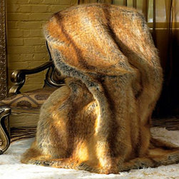 Golden Fox Faux Fur Throw - If you're not so sure about the fox trend, grab a cozy faux fox fur throw to lay over the back of a chair.