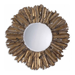 Uttermost - Hemani Antiqued Gold Leaf Round Mirror - The decorative hand forged and hand hammered metal frame has an antiqued gold leaf finish with burnished edges and a light gray wash. Mirror has a generous 1 1/4 inch bevel.