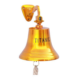 "Handcrafted Model Ships - Solid Brass Titanic Ship's Bell 15"" - Brass Bell - Elegantly designed and gleaming with a lustrous shine, this fabulous Brass Titanic Ship's Bell 15"" is equally stunning indoors or out. In addition to being fully functional, this hanging brass bell is a great addition to any nautical decor themed room. Make a statement with this titanic memorabilia and enjoy this wonderfully decorative style and distinct, warm ""strike through"" nautical tone with each and every resounding ring. Note: Each ships bell's length is measured from the highest point of its hanger to the lower lip of the bell, while the width is the diameter of the flared bell opening. Dimensions: 9.5"" Long x 9.5"" Wide x 15"" High"