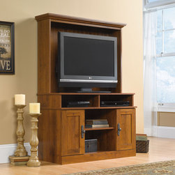 "Sauder - Harvest Mill Entertainment Center - Sophisticated hardware decorates doors and drawers. The cabinetry design is classic and clean for media, display and storage. All pieces feature modern technology solutions while maintaining the irresistible warmth and mood with the golden tones of our new Abbey Oak finish. Features: -Holds TV weighing 95 lbs or less.-Cubby hole storage features one adjustable shelf holds audio and video equipment.-Storage area behind doors holds DVDs and CDs.-Made in USA.-Abbey oak finish.-Harvest mill collection.-Distressed: No.-Powder Coated Finish: No.-Gloss Finish: No.-Material: Engineered wood.-Solid Wood Construction: No.-Non Toxic: Yes.-Scratch Resistant: No.-TV Size Accommodated: 37"".-Recommended TV Type: can hold TV weighing no more than 95 lbs.-Pull Out TV Swivel: No.-Integrated Flat Screen Mount: No.-Expandable: No.-Media Player Storage: Yes.-Media Cable Hole: Yes.-Adjustable Shelves : Yes.-Removable Shelves : Yes.-Number of Cabinets: 2.-Number of Doors : 2.-Door Attachment Detail : Hinges.-Interchangeable Panels : No.-Handle Design: Knobs.-Hardware Finish: Antique bronze.-Interchangeable Handles: No.-Removable Back Panel: No.-Lighted: No.-Swatch Available: Yes.-Commercial Use: No.-Eco-Friendly: Yes.-Product Care: Wipe clean with damp cloth.Specifications: -EPP Compliant: Yes.-JPMA Certified: No.Dimensions: -TV opening dimension: 28.5'' H x 39'' W.-Overall Height - Top to Bottom: 58.75"".-Overall Width - Side to Side: 41.5"".-Overall Depth - Front to Back: 16.75"".-TV Compartment Depth - Front to Back: 15.5"".-Shelf Width - Side to Side (Middle bottom) : 17.5"".-Shelf Width - Side to Side (Sides) : 5.13"".-Shelf Depth - Front to Back : 15.5"".-Overall Product Weight: 107 lbs.Assembly: -Assembly Required: Yes.-Tools Needed: Phillips head screwdriver, hammer.-Additional Parts Required: No.Warranty: -Manufacturer provides 5 year warranty."