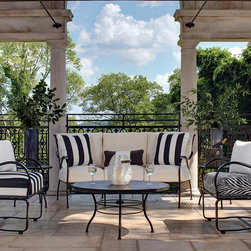"Frontgate - Paris 36"" Round Faux Stone Outdoor Coffee Table, Patio Furniture - Crafted from hand forged wrought iron. Ultra UV resistant Ebony finish. Timeless lattice design. Electro-galvanized iron treatment provides weather resistance. Tables require some assembly. From the Arc de Triomphe to the Eiffel Tower, the Paris Round Dining Table is a blend of boldness and stately sophistication. Paris strikes a curvaceous pose in classic wrought iron, boasting a transitional statement of timelessness. The seat and back pattern is formed by stamped steel that is electro-galvanized, then powder coated in an ultra UV resistant finish.. . . . ."