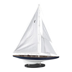Authentic Models - 1934 Rainbow J-Yacht Model - The model is hand made in wood, planks on frame. Hand tooled scale hardware. Inlaid deck strips simulate the original teak deck. Detailed rigging and sails. Made of Wood, Cotton, and Brass. Blue, and White Finish. 25.6 in. W x 5.7 in. D x 34.1 in. HRainbow; the 1934 American defender. The challenger; the British Royal Yacht Club 'Endeavour'. Designed by Starling Burgess and financed by an 18-member syndicate headed by Mike Vanderbilt. A magnificent J-Yacht, with an overall length of nearly 40 m. or 128 ft. and a sail area of 750 m2 (7535 sq. ft). A classic racer, legendary nautical history by now. A beautiful contemporary model at attractive cost. Numbered and dated certificate supplied.