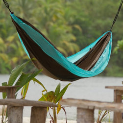 La Siesta - La Siesta Colibri Double Travel Hammock - CLH20-3 - Shop for Hammocks from Hayneedle.com! Traveling is easy with the La Siesta Colibri Double Travel Hammock. Designed for quick and easy suspension and dismounting this hammock can be suspended from just about anything including tree trunks and rocks. Made from super soft ultralight breathable and fast-drying parachute silk (nylon triobal) this hammock saves space in your pack and is virtually weightless. The integrated suspension solution EasyAdjust includes two polyester ropes (3 meters each) and two ultralight UV-resistant hooks made from glass fiber reinforced polyamide. Attached loops on the side of the hammock are perfect for holding your toilet bag or drink and this hammock can also double as a blanket. Designed to hold one person up to 400 lbs this hammock comes in your choice of colors. Additional Features Multiple options for suspending your hammock Can use anything from tree trunks to rocks Attached loops for toilet bag or drink Can double as a blanketAbout La SiestaSpecializing in the development marketing and distribution of hammocks and hammock chairs since 1991 La Siesta focuses on offering the best quality hammocks and hammock chairs while holding themselves to the highest standard when it comes to respecting nature the environment and human interaction with both. Following the most stringent manufacturing standards La Siesta's products are not only well-made but also original unique and beautiful. Great thought and care is put into the composition of colors and style in both their hammocks and hammock chairs. A leader in the development of sustainable practices La Siesta ensures their products are manufactured in a manner that is respectful for both humans and nature.