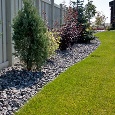 Traditional Landscape by Salisbury Landscaping