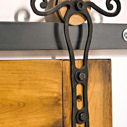 Scroll Barn Door Hardware - Shown with a wooden wheel this Rod Iron barn door hardware can be customized to use any style wheel or color.  We make all our barn door products in the shop and import all raw materials from the USA.