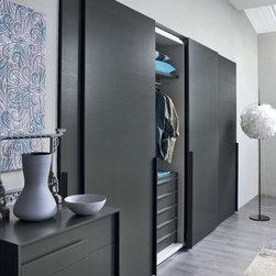 "Custom Made Closets with Sliding Doors - Contemporary closet with ""Alfa"" sliding doors combined with distinctive ""Flap"" handle from Novamobili."