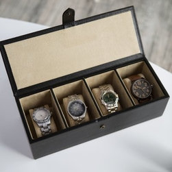 "Big Watch Box in Soft Leather - 12.25W x 3.5H in. - Bigger watches are en vogue with today's fashion-savvy males, and Redd Leather's Big Watch Box in Soft Leather - 12.25W x 3.5H in. provides safe and stylish storage for four of your favorites. (Or as the perfect gift to the fashion-savvy watch-wearer in your life.) The box was constructed of classic, full-grain leather and features four deep compartments lined with faux suede pillows that provide a damage-free zone for your watches when you aren't wearing them. Available in your choice of black or chocolate, the box is rectangular in its shape, measuring 12.25 inches wide, 4.75 inches deep and 3.5 inches tall. The box fastens securely on the outside with a snap-lock leather tab closure. About Redd Leather:Conceived in the spring of 2006 and located in Melbourne, Australia, Redd Leather prides itself in the quality, design, functionality and style of its leather goods products. The company sells all things leather, from leather housewares and leather photo frames to leather travel accessories and leather storage products. Redd Leather's goods come in differing sizes and varying colors while employing several types of unique leathers, including croc prints, Nappa, full grain and quilted. As their website proudly states: ""We are leather. We hear leather. We heart leather."" See more at reddleather.com."