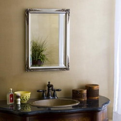 Basix Plus Vanity Mirror - Dimensions:16W x 22H inches16W x 26H inches20W x 26H inches24W x 30H inches The Basix Plus Vanity Mirror brings beautiful simplicity to your bathroom designs. A beveled mirror rests securely inside a solid wood frame accented with hand carved details at the corners. Available in a variety of colors and sizes the mirror easily matches your specific decorative needs.