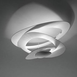 """Artemide - Artemide Pirce Mini ceiling light - The Pirce Mini Ceiling Light from Artemide has been designed by Giuseppe Maurizio Scutelle . The unique design of this ceiling fixture will double as a piece of art in your home, gallery or office. The sleek spiral fixture is crafted from one continuous slender piece of stainless steel aluminum. This fixture requries 1 x 300W R7s Hal or 1 x 42W LED (included). cUL LISTED.      Product Details:  The Pirce Mini Ceiling Light from Artemide has been designed by Giuseppe Maurizio Scutelle . The unique design of this ceiling fixture will double as a piece of art in your home, gallery or office. The sleek spiral fixture is crafted from one continuous slender piece of stainless steel aluminum. This fixture requries 1 x 300W R7s Hal or 1 x 42W LED (included). cUL LISTED.  Details:     Manufacturer: Artemide   Designer: Giuseppe Maurizio Scutelle    Made in: Italy   Dimensions: Height: 14 3/16"""" (36 cm) X Width: 27 3/16"""" (69 cm)   Light bulb: 1 x 300W R7s Hal or 1 x 42W LED (included)   Material: Aluminum, Stainless Steel"""