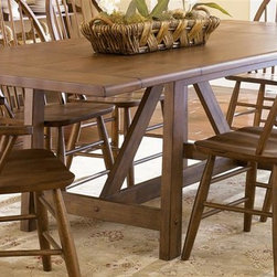 Liberty Furniture - Farmhouse Trestle Table - Chairs not included. Two 16 in. drop leaves. Weathered rustic surface. Warranty: One year. Made from select hardwoods and pin knotty oak veneers. Weathered oak finish. Made in Malaysia. Minimum: 66 in. L x 40 in. W x 30 in. H. Maximum: 102 in. L x 40 in. W x 30 in. H (161 lbs.)