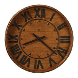 Howard Miller Wine Barrel 25 in. Wall Clock - Your rustic kitchen includes aged and beloved pieces such as a thick butcher block and the Howard Miller Wine Barrel 25-in. Wall Clock. You can almost smell the hearty beef stews and taste the tangy nip of wine. This clock shares the fun of old wine barrel style with the quality of its Howard Miller quartz movement. The frame is one type of oak (Heirloom) and the face is made of another type of veneered oak (Yorkshire) - a winning combination that honestly adds warmth and personality to any room - not just the kitchen. Metal details include numerals hands round markers and an authentic-looking metal center ring. This gallery wall clock requires one AA battery (not included). With a glance to the wall clock and a few culinary cues to tease your senses you'll find yourself in the mood for a food and wine adventure. The Howard Miller StoryIncomparable workmanship unsurpassed quality and a quest for perfection - these were the cornerstones of the company Howard C. Miller founded in 1926 at the age of 21. Even then Howard Miller understood the need to create products that would be steeped in quality and value. Howard Miller was schooled in the fine art of clockmaking by his father Herman in the Black Forest region of Germany. Howard developed into a visionary whose keen sense of innovation spawned a tradition of excellence that has been uncompromised through three generations. A highly respected brand Howard Miller maintains its popularity because of the company's commitment to quality. Every product manufactured at the company's sprawling facility in Zeeland Michigan undergoes stringent tests and exceeds industry standards to ensure a lifetime of enjoyment.