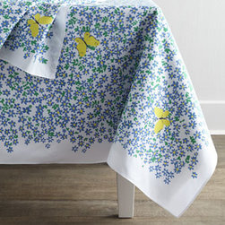 "Paule Marrot Editions - Paule Marrot Editions ""Myosotis"" Tablecloth, 67"" x 108"" - A recreation of a textile pattern from quintessential French textile artist Paule Marrot, these table linens feature an expressive field of blue forget-me-nots (myosotis sylvatica) punctuated by vibrant butterflies. The design reflects a compositionally..."