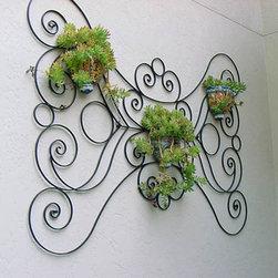 Artistic work - Custom ornamental wall plant hanger