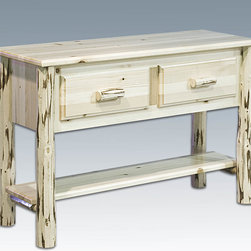 "Montana Woodworks - Montana Sofa Table, Lacquered - This delightful yet practical table serves to hold and keep safe the many items otherwise found in entry or living areas. With two spacious drawers (15"" W x 12"" D x 5"" H) and a 47"" x 9"" shelf underneath, you will have display and storage space to spare. Handcrafted in Montana using solid, American grown wood with genuine lodge pole pine accents that are skip peeled by hand with old-fashioned draw knives to ensure a unique, one-of-a-kind appearance that will last for generations to come. Comes fully assembled. 20-year limited warranty included at no additional charge. Hand Crafted in Montana U.S.A.; Solid, U.S. grown wood; Skip-peeled by hand using old fashioned draw knives.; Heirloom Quality; 20 Year Limited Warranty; Durable Build, Fit and Finish; Each Piece Signed By The Artisan Who Makes It; Solid Wood, Edge Glued Panels; Solid genuine lodge pole pine Legs and Trim. Dimensions: 48""W x 17""D x 33""H"