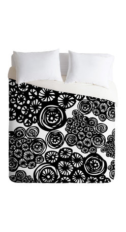 Julia Da Rocha Circo Doodles King Duvet Cover - A cyclone of swirling wheels animates this dynamic duvet cover designed by Julia Da Rocha. The striking black and white pattern is custom printed on soft, easy-care woven polyester. A hidden zipper makes it easy to remove the cover for cleaning. Need a little change of pace? The reverse side is solid white.