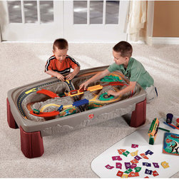 """Step2 - Deluxe Canyon Train & Track Table with Lid - The Deluxe Canyon Road table is the perfect solution to your train track woes! With a molded-in track and non-removable bridges, you will never again have to reset your children's track or lose pieces of track around the house. The flat top lid covers the table and its contents for easy cleanup and also allows it to be used as an additional play surface or tabletop for snack time. Features: -Extra large table with built-in, multi-level track provides hours of fun for multiple children. -Molded-in track keeps kids playing without the need for constant re-assembly. -Horizontal layout puts entire surface within reach of younger children. -Designed to fit BRIO, Thomas & Friends, Hot Wheels, Matchbox, and other playsets (not included). -Sturdy poly construction and neutral colors complement family and play rooms, are easy to clean, and will last for years. -Lid doubles as a table top for additional play space. -Minimal adult assembly required. -Some accessories included (will vary). -Art supplies not included. -Ages 3 and up. -Material: Plastic. -Includes a 3-piece train and cars. -Overall dimensions: 16"""" H x 47"""" W x 26"""" D, 24 lbs."""