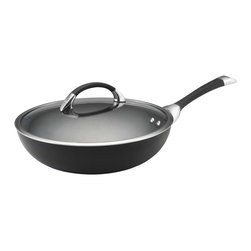 Circulon - Circulon Symmetry Hard Anodized 12 Inch Nonstick Ultimate Chefs Pan - The Circulon Symmetry Hard-Anodized Nonstick 12-Inch Covered Essentials Pan lives up to its name, ideal for making everything from lean shrimp fajitas, to sauted zucchini with garlic, and more. The essential pan's attractive exterior adds sophistication and style to any kitchen dcor, and the heavy-duty hard-anodized aluminum construction is twice as hard as stainless steel. The pans metal utensil safe interior features the TOTAL Food Release System of circles to reduce surface abrasion. The DuPont Autograph advanced 3-layer nonstick offers easy cleanup both inside and out while delivering extraordinary food release. A dual-riveted rubberized stainless steel handle offers a comfortable grasp, and the shatter-resistant glass lid allows food to be monitored while locking in heat and moisture. The dishwasher-safe essential pan is oven safe to 400F and a great addition to Circulon cookware collections, thanks to its superior nonstick technology.