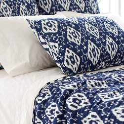 Varkala Indigo Quilted Sham - The classic pairing of blue and white is reimagined in a diamond pattern that is at once playful and refined. Named after a beach in India, the Varkala Indigo Quilted Sham is made of a soft and drapey lightweight cotton that imparts the airiness of a languid summer's day. A beautiful complement to the Varkala Indigo Quilt, the sham's reversible pattern is exclusive to its color combination.