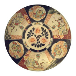 """Pre-owned Large Japanese Imari Charger - A lovely hand decorated antique porcelain charger...Yes that sounds incredibly boring, however it IS lovely and there is a reason the Japanese have done organic decoration for centuries.     This is a tremendous statement piece. This beautiful hand decorated antique charger has great stature at 18"""" inches in diameter with great colors for today's decor: shades of navy, orange and parrot green which all work especially well with gold and brass. Pieces of this age and quality are great with traditional decor as well as fabulous contrast in modern settings. This piece dates to somewhere between 1880 and 1910 and you can see how it was right at home with arts & crafts and art deco.    This charger would look great in a collection. Please see seller's other listings for other chargers and decorative pieces."""