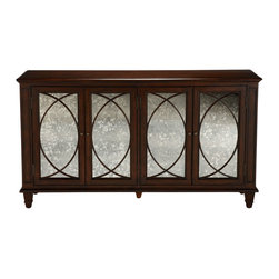 Ethan Allen - Brandt Buffet - This buffet gives any interior instant ambiance. Two pairs of wood-frame doors are adorned with antiqued mirror glass and circular-cut mullions. Tapered legs and a rich Cello finish lend it an unmistakably luxurious look.