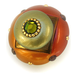 "Susan Goldstick - Mini Duo Knob Copper Deep Gold 2 in. - The Mini Duo Knob Copper is colored in copper orange, deep gold and soft jade green. The knob stem is painted in gold to complement the metal accents and a Swarovski olivine crystal offers shimmer. It's divided color design is a unique characteristic of our Duo collection and can be coordinated with the smaller 1 1/2"" diameter knob and the Duo square. Suggestion: The warm color scheme make this knob a perfect accent for cabinetry with wood stains that have paprika tones and brownish hues."