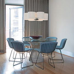 """Bertoia Side Chairs - In 1966, the Platner Collection captured the """"decorative, gentle, graceful"""" shapes that were beginning to infiltrate the modern vocabulary. The iconic pieces are created by welding hundreds of curved steel rods to circular frames, simultaneously serving as structure and ornament."""
