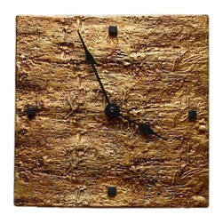 Zsofia + Istvan - Zsofia + Istvan Slab Handmade Ceramic Wall Clock / Golden Glaze - A clock made based on philosophical principals. A Middle Eastern ambiance and feeling is created by a wooden print. This print was formed naturally in the wood piece by an insect called the woodworm. This print symbolizes the intangibility of time.
