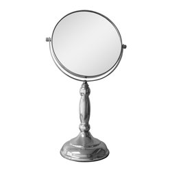 None - Free Standing Oval 5X Magnifying Makeup Mirror - The free standing mirror with 5X magnification is perfect for makeup application,plucking,tweezing and more. Made of metal in a chrome finish,this mirror has an elegant oval shaped stand. Mirror size - 6.7 inch.