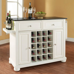 Crosley - Crosley Alexandria Solid Black Granite Top Wine Island with Bun Feet - KF31004AM - Shop for Kitchen Islands from Hayneedle.com! Make the Crosley Alexandria Solid Black Granite Top Wine Island with Bun Feet the center of attention in any dining room or kitchen. This beautiful island is made of select wood and veneers. It's available in your choice of finish and comes with an elegant black granite top. Use it to add extra workspace in your kitchen or as the perfect place to prepare and serve wine and appetizers at your next gathering. Storage options include two utility drawers for napkins utensils bottle openers and other necessities while side cabinet doors open to reveal space for plates or appliances. This island is designed with a built-in rack that holds up to 20 bottles of your favorite wine. Its wine valet offers a handy way to keep a pair of bottles on display and ready for pouring. A side bar keeps towels handy for spills and cleanup. About Crosley FurnitureIn 1920 Powel Crosley founded the company that pioneered radio broadcasting and mass market manufacturing around the world starting with a simple radio meticulously crafted with obsessive detail and accuracy and a measure of consideration for the wallet. These high ideals have served the company well for over 90 years and they live on in the newest addition to the family. Crosley Furniture sets a new standard for innovation function and meticulous craftsmanship in the manufacture of value-priced furniture. They proudly offer durable furniture products featuring hardwood and veneer construction with rich multi-step finishes in a multitude of styles.