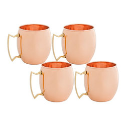 Solid Copper Moscow Mule Mugs, Set of 4 - These unique and stylish solid copper mugs  have comfortable solid brass handles, making for easy lifting!   The mug of choice when serving  the famous Moscow Mule - a refreshing cocktail made of ginger beer, vodka and a dash of lime juice.