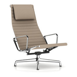 Herman Miller - Herman Miller Eames Aluminum Lounge Chair with Headrest, Fabric - Herman Miller Eames Aluminum Group Lounge Chair with Headrest, Fabric  Tilt and Swivel Base  by Charles and Ray Eames How do you make a lounge chair better? You add a headrest and tilting base. This piece takes the iconic Eames Aluminum Group Lounge Chair and adds a few more features that takes this lounger to new levels of comfort. Like other pieces from the Eames Aluminum Group this Lounge Chair features a lightweight aluminum frame with suspended fabric upholstery. The fabric upholstery, available in a variety of fabric types and colors, is a more affordable but equally stylish alternative to the more traditional leather. This Aluminum Group Lounge Chair is formidable enough to look great on its own, but combine it with other pieces from the Eames' Aluminum Group collection for a complete look. See the entire Eames Aluminum Chair Group.
