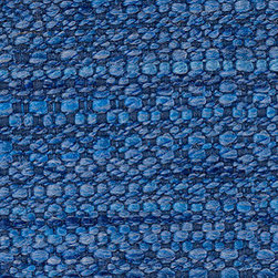 Rivington Sapphire Fabric - This soft boucle fabric is very durable and provides a luxurious look and feel for any modern furniture piece.