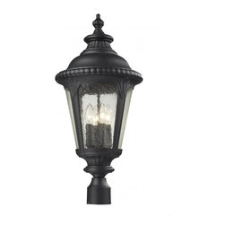 Four Light Black Clear Seedy Glass Post Light - Traditional and timeless, this large outdoor post head fixture combines black cast aluminum hardware with seedy glass for a classic look.
