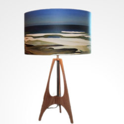 """The 41 Across the Bay, Large - The waves and colors from the sea can now flow right into your home with The 41 Across the Bay table lamps by Californian artist Rowan Chase. These unique lamps are constructed on white powder coated lampshade rings with Rowan Chase artwork. 100% Cotton Velvet Watercolor paper and a mahogany body. They are handmade in California one lamp at a time by Rowan Chase himself in his studio. Available in two sizes; 12"""" and 15"""". Overall height is 24"""" with a base of 8"""" wide at foot"""