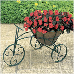 Tricycle Flower Planter - I'm a sucker for playful planters. This tricycle is in bright green and would make a great addition to a traditional patio. The wheels have great details and it holds a very large plant.