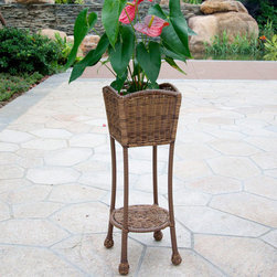 "Jeco - Honey Wicker Patio Planter Stand - With durable, all-weather resin wicker over a powder-coated steel frame, this planter stand is built to withstand anything life throws your way. Unlike real wicker which dries out and cracks, resin wicker is flexible and fade-resistant, which means it stays like new season after season. What's more, all-weather wicker doesn't absorb water and also allows for air flow, making it the perfect choice for the poolside! In addition, this planter is virtually maintenance-free and cleaning it is as simple as spraying it down with your garden hose or wiping it with a solution of mild dish soap and water. ; Steel frame for extra durability; All weather resin wicker to withstand seasons of inclement weather; Lower shelf for extra storage; Hose off and wipe clean; Comes fully assembled; Dimensions: 10.25"" X 10.25"" X 27.5"", 11 lbs"