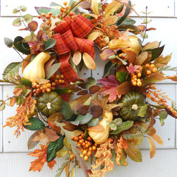 Harvest Fall Wreath by DeLaFleur - The foliage and berries adorning this wreath are pretty reminders of why fall is my favorite season. The colors blend beautifully.