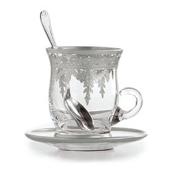 Vetro Silver Cup and Saucer with Spoon - Gracefully made with an elegant s-curve form to its walls, the Vetro Silver Cup and Saucer with Spoon further distinguishes its silhouette with a low-set handle. The hand-painted, hand-etched cup of glass and silver leaf sets into a matching high-edged saucer, while a matching spoon makes it a charming gift set - or allows the stirring of your tea or cappuccino in flawless style.