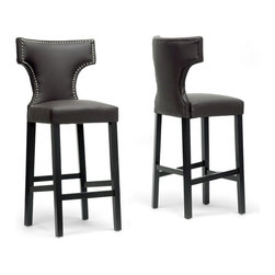 "Baxton Studio - Baxton Studio Hafley Brown Modern Bar Stool (Set of 2) - Update your kitchen or bar area with a stool that is a breath of fresh air. Hafley's hallmark is beautiful, soft, buttery brown faux leather. This Chinese-made bar chair also includes a wooden frame with black lacquer base, polyurethane foam cushioning, and trendy silver nail head trim. The Hafley Designer Bar Stool requires assembly and is also available in beige (sold separately). Easily maintain the appearance of your new stool by wiping clean with a damp cloth before immediately drying the surface. Product dimension: 21.37""W x 18.75""D x 45.75""H, seat dimension: 17.87""W x 15.75""D x 30.87""H"