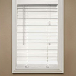 Home Decorators Collection White 2-Inch Faux Wood Blind - It's hard to beat a white wooden blind. It's so classic and classy and makes a great base layer. The windows in my home have white wood sills, and these would match well.