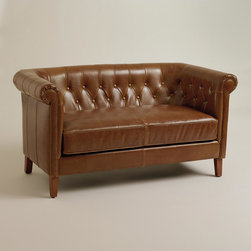 World Market - Essex Loveseat - Inspired by the classic Chesterfield-style sofa, our handsome Essex Loveseat features rolled shelter arms and deep tufting for ultimate comfort. Its casual bi-cast leather upholstery in distressed whiskey brown gives it a worn look and supple feel.